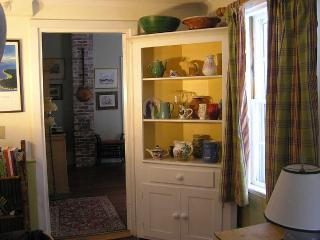 The corner cupboard houses part of Cathy's jug and pot collection.