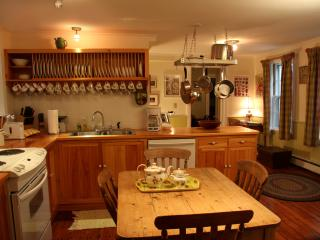 The lovely old original kitchen.  Dishwasher, washer-dryer. English pine table for informal meals.