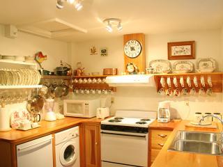 Elegant European style kitchen, with fine English china, dishwasher, washer/dryer, fridge/freezer