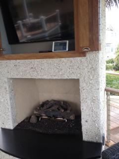Outdoor Fireplace in Grand Tiki with TV