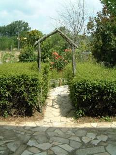 The path from La Florette's kitchen to the back garden and patio,