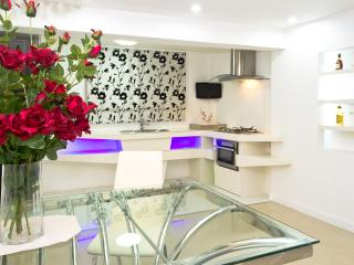 Our Beautiful Kitchen seen from our Dinning Table with a mini Plasma TV to even watch your best show