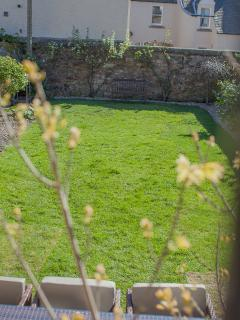 View of private walled garden from upper patio