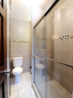 bathroom with a shower cabin entered from the hallway