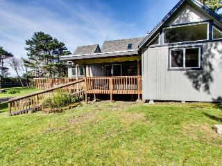 Dog-friendly home w/ a wood-burning fireplace & ocean views - close to the beach