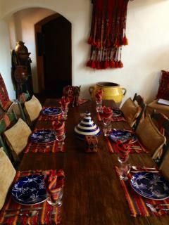 The dining table in the main house..