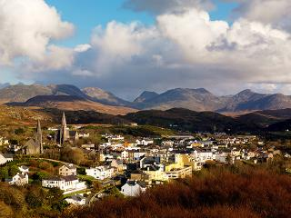 Clifden Town with the Connemara Mountains in the background.