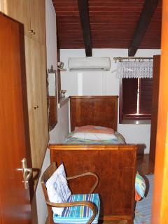 room with two single beds and private shower and toilet
