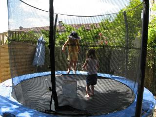 Theres a large trampoline in a shady corner of the shared central area
