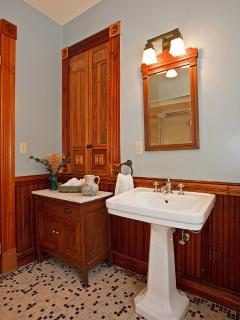 Bathroom upstairs and private to the Pacific bedroom as well as a door to hallway.