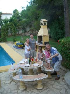 OUR OWN FAMILY FUN WITH A LARGE TILED BBQ AND STONE SEATING BY THE POOL
