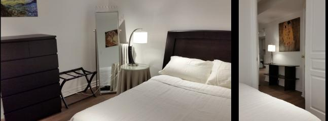 Bedroom equipped with large walk-in closet and en-suite laundry for added convenience