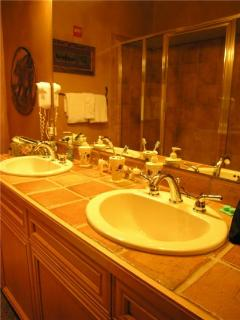 Master suite bathroom with 2-sinks and private steam shower