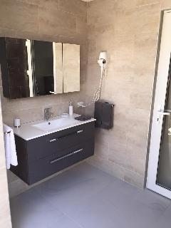 your bathroom is roofed and outdoor in your private garden