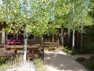A lovely grove of aspens shelter the front entry and deck