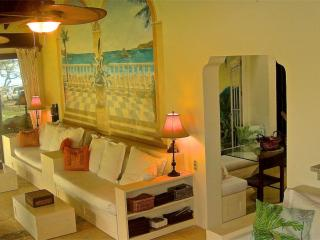 35' Livingroom with soaring Cathedral Ceilings and stunning view of the Pacific.