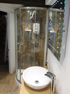 The shower enclosure in the bathroom