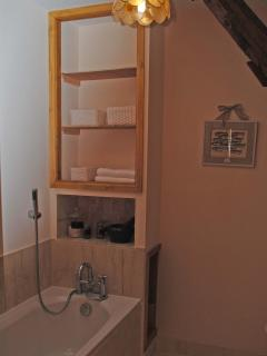 Upstairs family bathroom with large bath to soak in, toilet and basin area