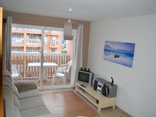 this is the lounge with the balcony outside which overlooks the beach