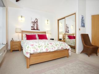 Oaked framed king-sized bed with goosedown duvet.