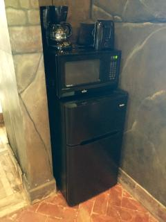 Bar fridge, microwave, coffee maker and toaster