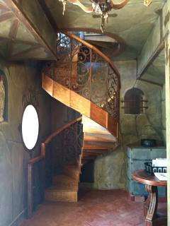 Spiral staircase leading up to the bedroom