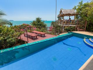 View from Pool Level Master Bedroom towards Sun Deck, Outdoor Shaded Dining Area- and Ocean!