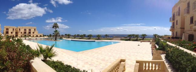 View of pool and sea from private terrace