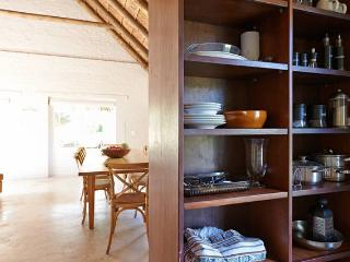 The kitchen pantry with views into the sitting room