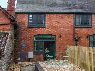 1 STABLE COTTAGE, end-terrace, upside down accommodation, front garden, in