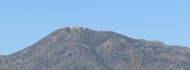 Famous monastery on distant mountain