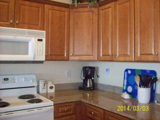 Well equipped kitchen with dishes, pots pans crock pot