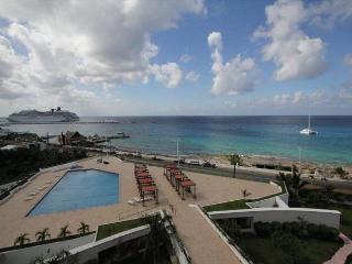 Oceanfront with pool 2 bedroom deluxe condo in Palmar condos (PM6E), Cozumel