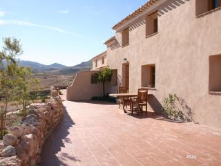 Settled in the mountains between two traditional remote whitewashed spanish villages