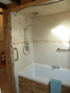 New fully refurbished ensuite bathroom with shower-over-bath; bedroom 1