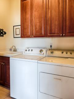 The laundrey room has a large washer, dryer & soaking sink. We supply iron & board.