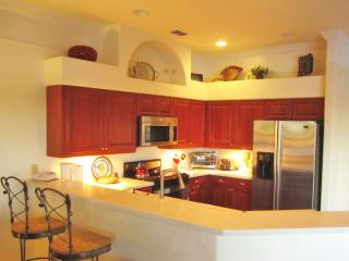 Our kitchen is open to our family room and the pool area.