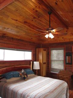 King-size bed with hand-crafted cedar headboard