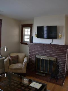 Open log fireplace with basic cable TV