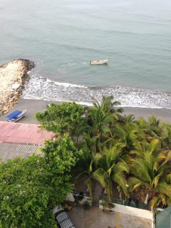 View looking down from enclosed balcony with direct private access to Laguito beach.