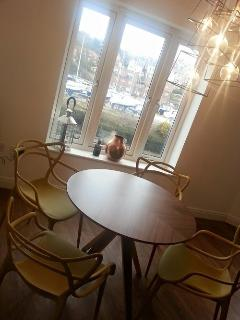 Gorgeous retro styled open plan dining area, with stunning views of the Whitby Harbour