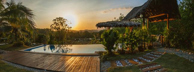 Sunset over the infinity pool and gardens