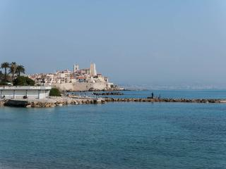 View from the beach across the road, view of Remparts, Picasso museum and old town