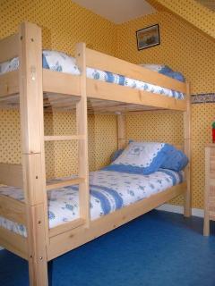 Bedroom 5: Bunk bedroom with garden views.