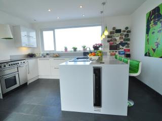The kitchen with wine cooler and views to the Atlantic Ocean