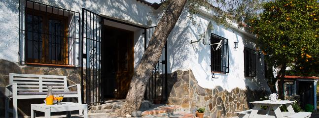 Cortijo and spacious front terrace with amazing views