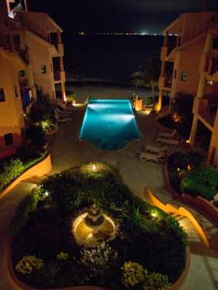 Luna illuminated at night overlooking pool