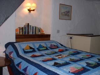 The double bedroom also  has old beams and a view over The Square.