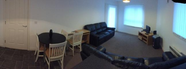 Panoramic of lounge and kitchen
