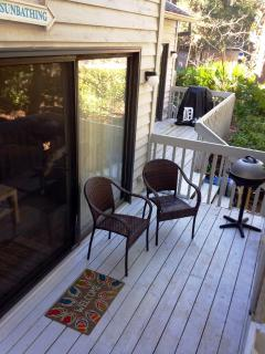 Deck with chairs and grill